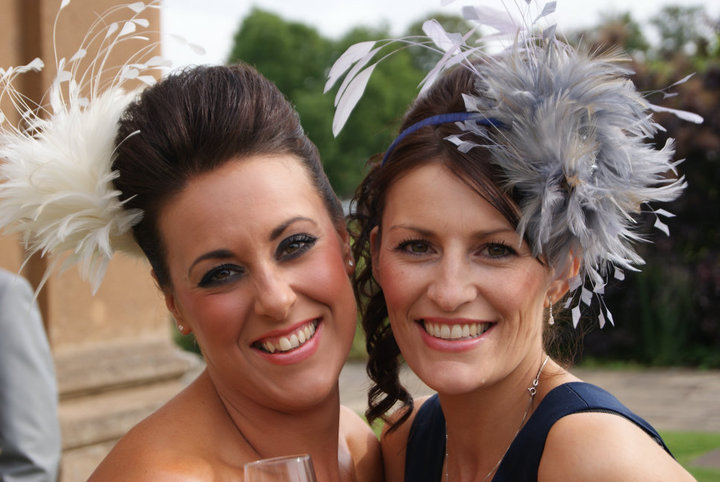 Ivory Feather Spray and Petwer and Navy Bespoke fascinator